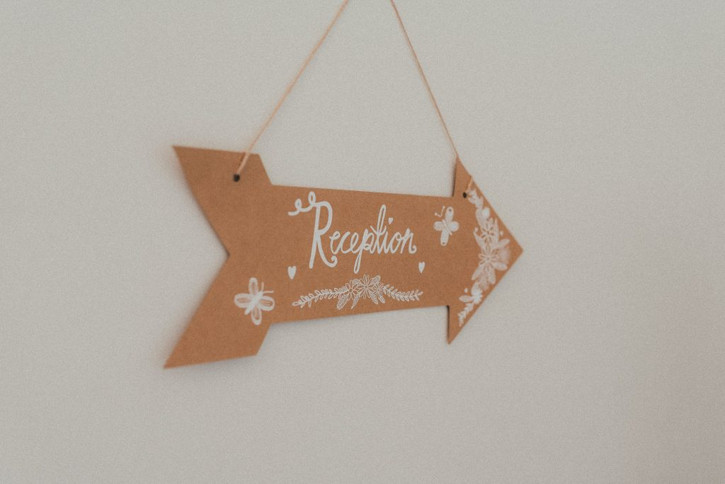 sign guiding guests to the reception