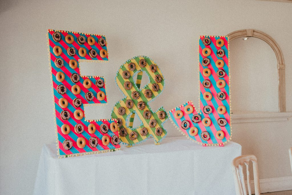 giant colourful E & J with doughnuts on