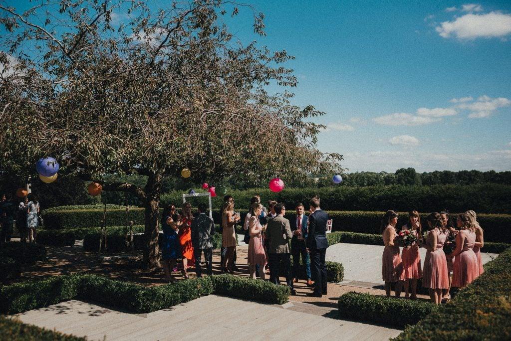 wedding guests enjoying the sun