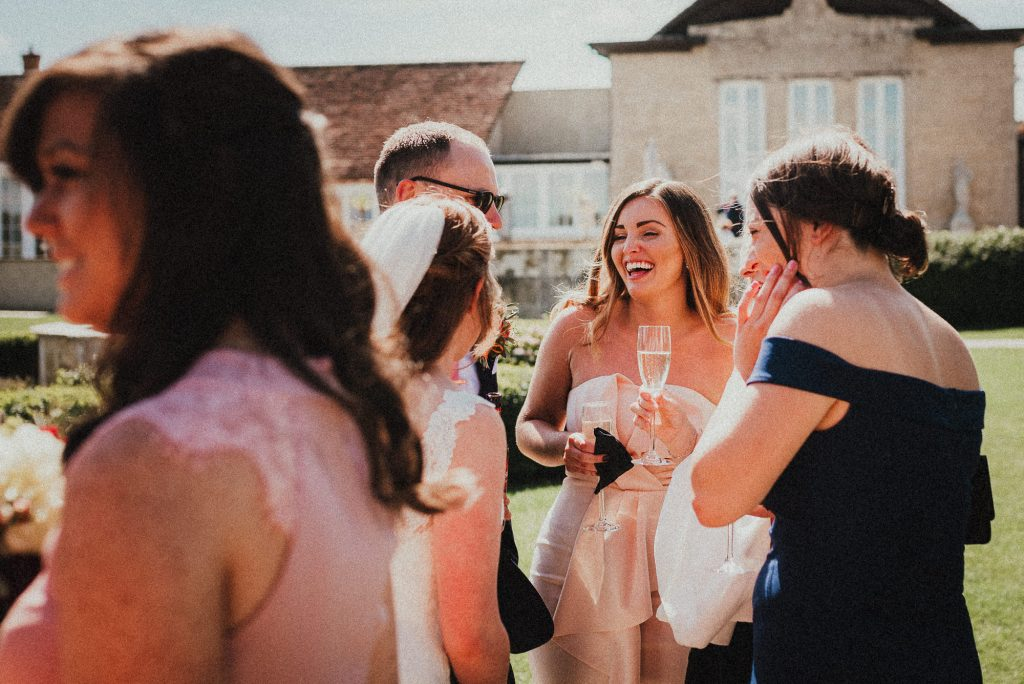 wedding guest laughing at a joke