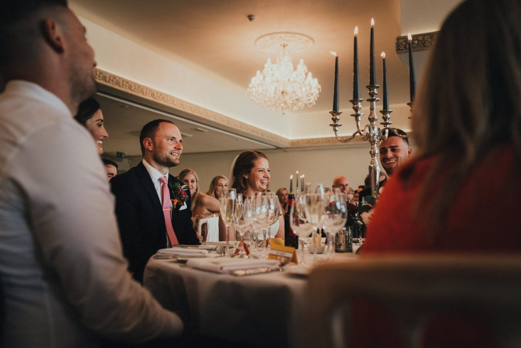 bride and groom react to speech
