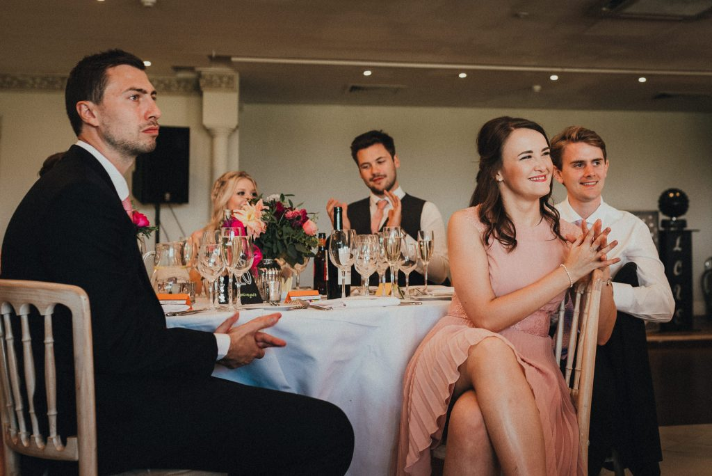 wedding guests laughing at speech