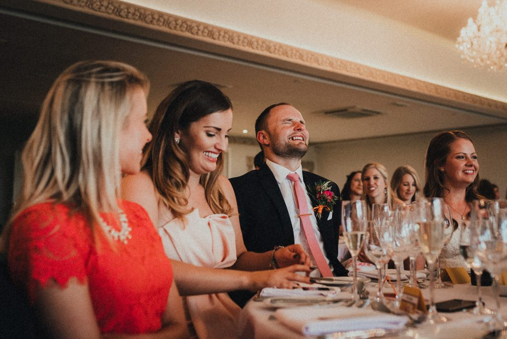 groom wincing during best man's speech