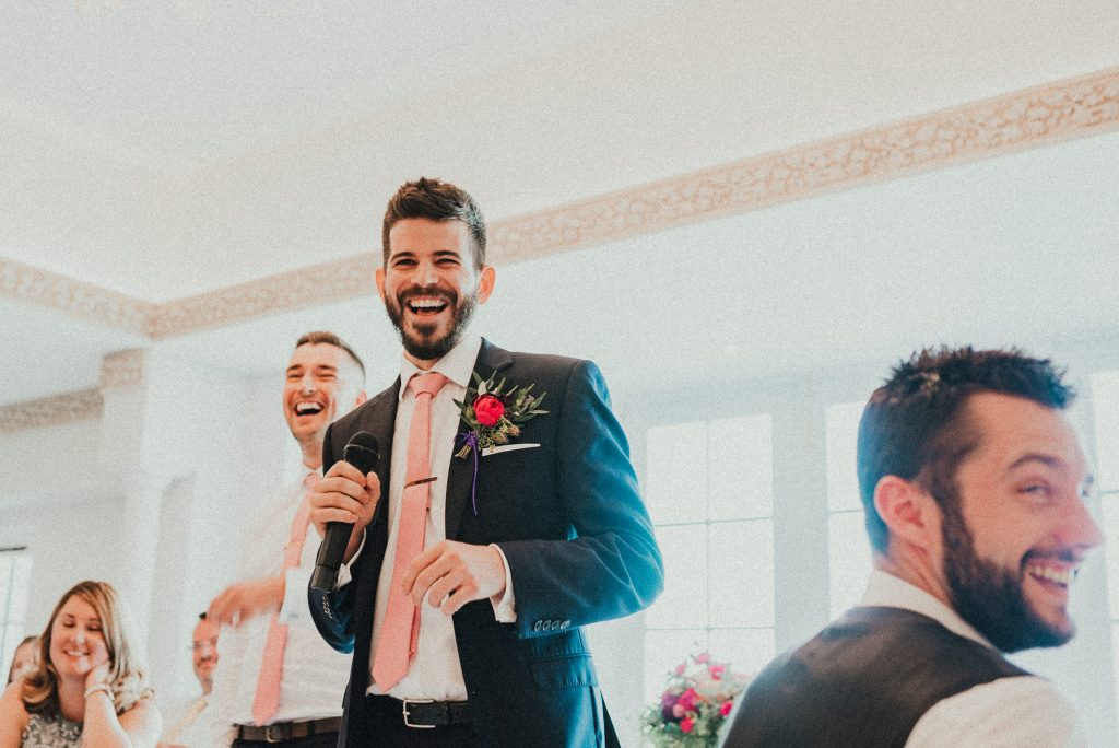 best men laughing at groom
