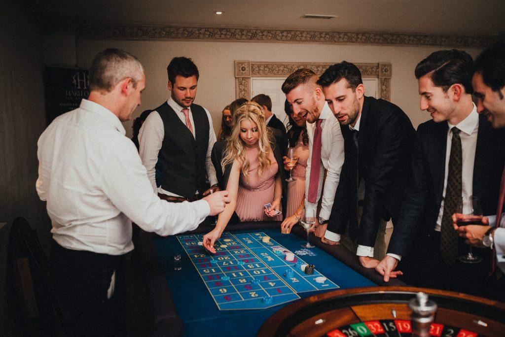 wedding guests enjoying fake casino