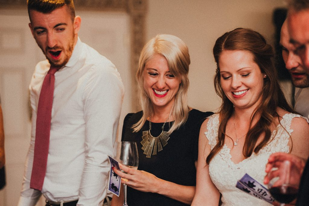 wedding guests laughing at casino