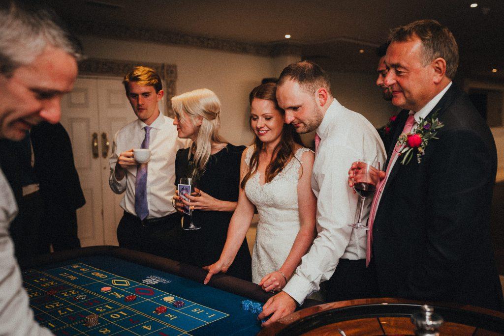 bride and groom placing bets at fake casino